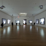 Installation view of Andy Warhol: Motion Pictures at The Museum of Modern Art, 2010. Left to right, Screen Test: Susan Sontag (1964), Screen Test: Dennis Hopper (1964), Screen Test: Kathe Dees (1964), Screen Test: Edie Sedgwick (1965), Kiss (1963-64), Screen Test: Lou Reed (1966), Screen Test: Kyoko Kishida (1964), Screen Test: Baby Jane Holzer (1964), and Screen Test: Donyale Luna (1964). ©2010 The Andy Warhol Museum, Pittsburgh, PA, a museum of Carnegie Institute. All rights reserved. Photo: Jason Mandella