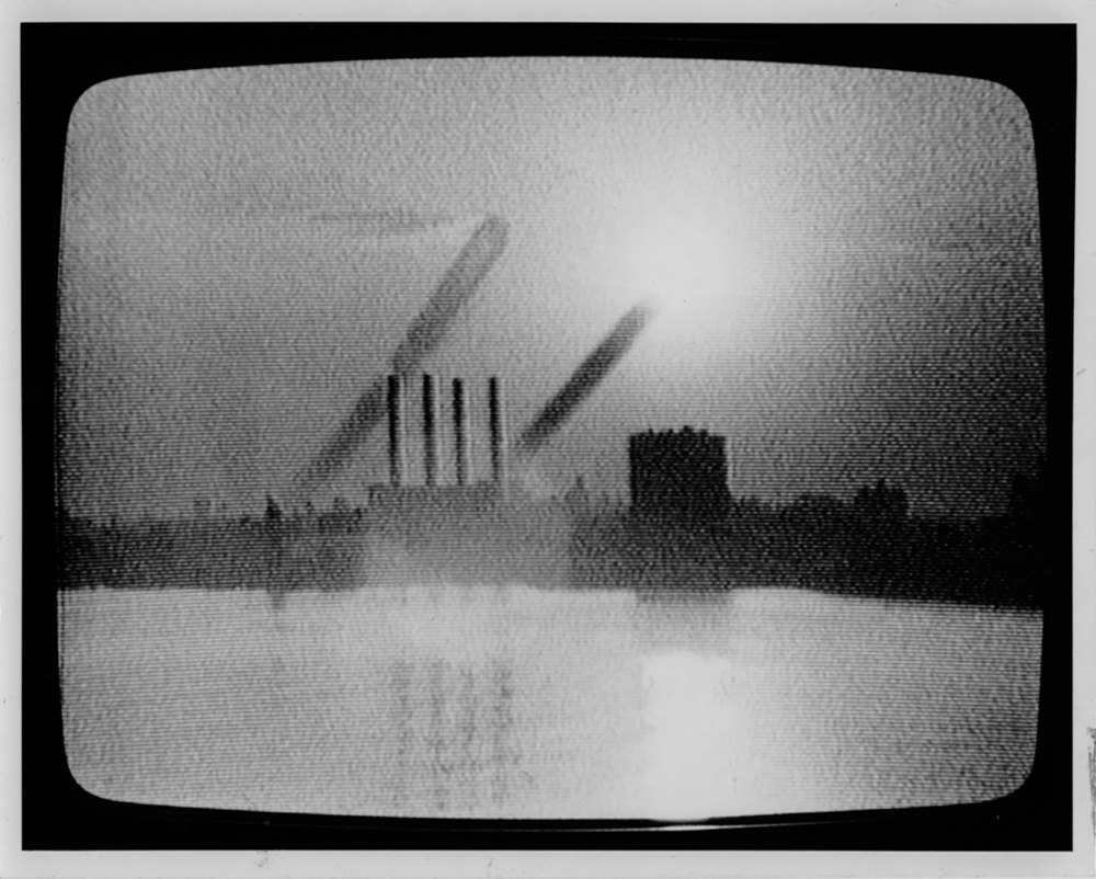 "Mary Lucier. Dawn Burn (detail). 1975. Seven monitors of increasing sizes from 15 to 25 inches diagonal; slide projector mounted on wall; seven-channel video converted from ½-inch, open-reel tape to DigiBeta and DVD (black and white, silent); one color slide (34:00 min., continuous). Structure: 7'3""–8' 2"" x 20' (approx.) x 20""–27"". Collection San Francisco Museum of Modern Art.Accessions Committee Fund: gift of Doris and Donald Fisher, Marion E. Greene, Evelyn and Walter Haas, Jr., and Leanne B. Roberts, 1991. © 2011 Mary Lucier"