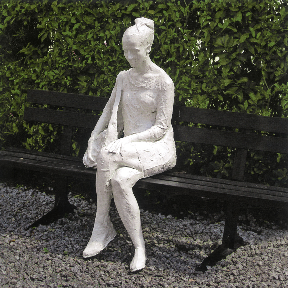"George Segal. Woman on a Park Bench. 1998. Bronze sculpture with white patina, metal bench. 52 x 72 1/2 x 37 1/2"". Courtesy The George and Helen Segal Foundation and Carroll Janis. © 2011 The George and Helen Segal Foundation; licensed by VAGA, NY"