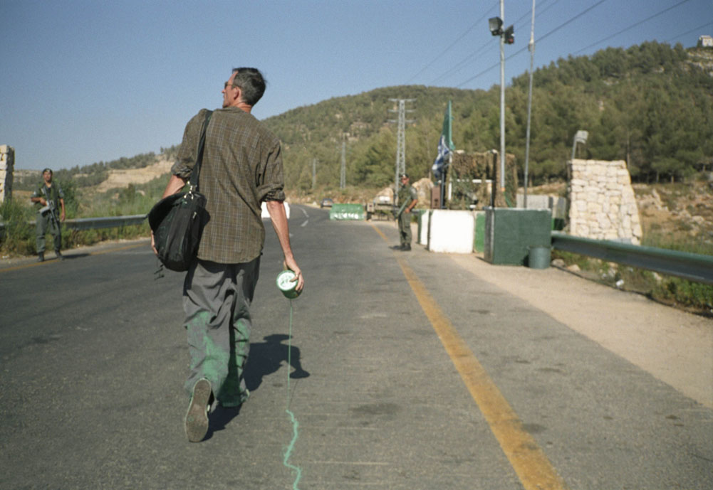 Francis Alÿs The Green Line (Sometimes doing something poetic can become political and sometimes doing something political can become poetic) 2005 Documentation of an action Edition of 1, EP Courtesy David Zwirner, New York