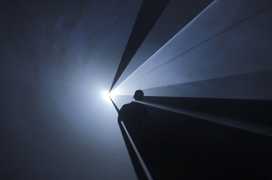"Anthony McCall. ""You and I Horizontal"" (2006). Installation view at Institut d'Art Contemporain, Villeurbanne, France (2006). Solid light installation. 50-minute cycle in six parts. Computer, computer script, video projector, haze machine. Dimensions variable. Photograph: Blaise Adilon. Courtesy Sean Kelly Gallery, New York."