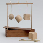 Froebel Gift No. 2: Sphere, Cylinder, and Cube. c. 1890. Wood and string, 11 1/4 x 10 1/4 x 3″ (28.6 x 26 x 7.6 cm). Manufactured by J. L. Hammett Co., Braintree, Massachusetts (est. 1863). The Museum of Modern Art, New York. Gift of Lawrence Benenson, 2011
