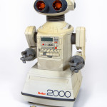 Century of the Child: Growing by Design 1900-2000 Omnibot 2000, remote-controlled robot. c. 1985. Various materials, 24 x 15 x 14″ (61 x 38.1 x 35.6 cm). Manufactured by Tomy (formerly Tomiyama), Katsushika, Tokyo. Space Age Museum/Kleeman Family Collection, Litchfield, Connecticut