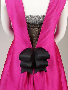 Cristóbal Balenciaga, Detail of cocktail dress of fuchsia silk shantung and black lace with black silk satin ribbons, summer 1966. Fine Arts Museums of San Francisco, the Eleanor Christenson de Guigné Collection (Mrs. Christian de Guigné III), gift of Ronna and Eric Hoffman