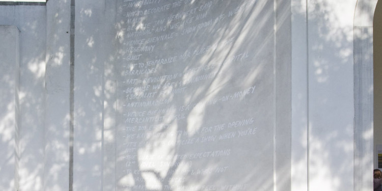 5_Anetta Mona Chisa & Lucia Tkacova_80 20_2011_white painted text on the facade of the Romanian Pavilion_dimensions variable_courtesy of the artists_photo Roman Mensing artdoc.de_2