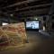 """Padiglione America Latina-IILA, 54. Esposizione Internazionale d'Arte-la Biennale di Venezia Veduta generale In primo piano: Olaf Holzapfel (Germania) con Teresa, Mirta, Dionisia, Noelia y Luisa Gutiérrez della comunità indigena Wichi (Argentina), """"Temporäres Haus"""", 2009-2010, Courtesy: l'artista e Johnen Gallery, Berlin In secondo piano: Martín Sastre (Uruguay), """"Episode I: Tango with Obama"""", 2009, Courtesy: l'artista Foto: Rodolfo Fiorenza"""