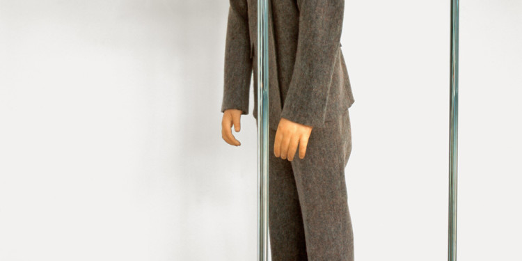 Maurizio Cattelan La Rivoluzione siamo noi, 2000 Polyester resin, wax, pigment, felt suit, and metal coat rack, figure: 123.8 x 35.6 x 43.2 cm; coat rack: 189.9 x 47 x 52.1 cm Courtesy of the artist. © Maurizio Cattelan Photo: Attilio Maranzano