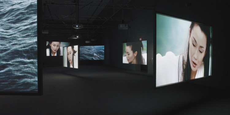 "Isaac Julien. Ten Thousand Waves. 2010. Installation view, Bass Museum of Art, Miami. Nine-screen installation, 35mm film transferred to High Definition 9.2 surround sound, 49' 41"". Courtesy of the artist, Metro Pictures, New York and Victoria Miro Gallery, London. Photograph: Peter Haroldt"